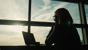 A business owner looks over the horizon for business success